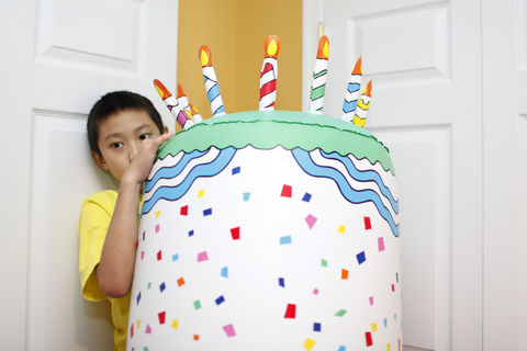 Times-Mirror Staff Photo/Beverly Denny Ethan, a student at the Aurora School in Leesburg for children with autism, climbs up the inflatable cake that was part of the school's 10th anniversary celebration July 12. Former Washington Redskins player Marcus Washington was a special guest and signed autographs.